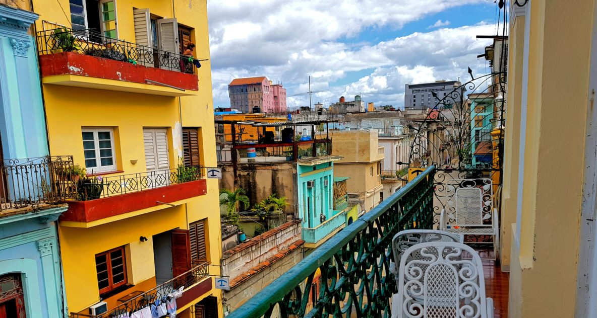 This balcony looks over the colorful streets of the Vedado neighborhood in Havana